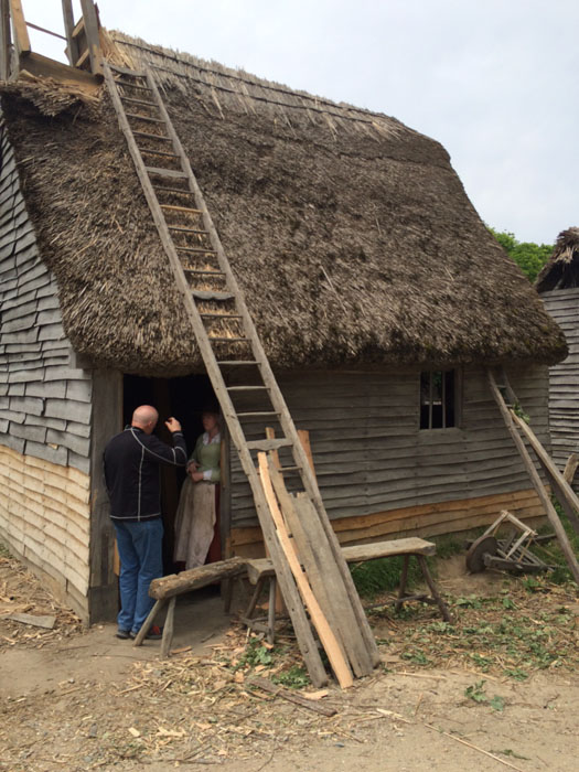 House with roof being repaired at Plimoth Plantation